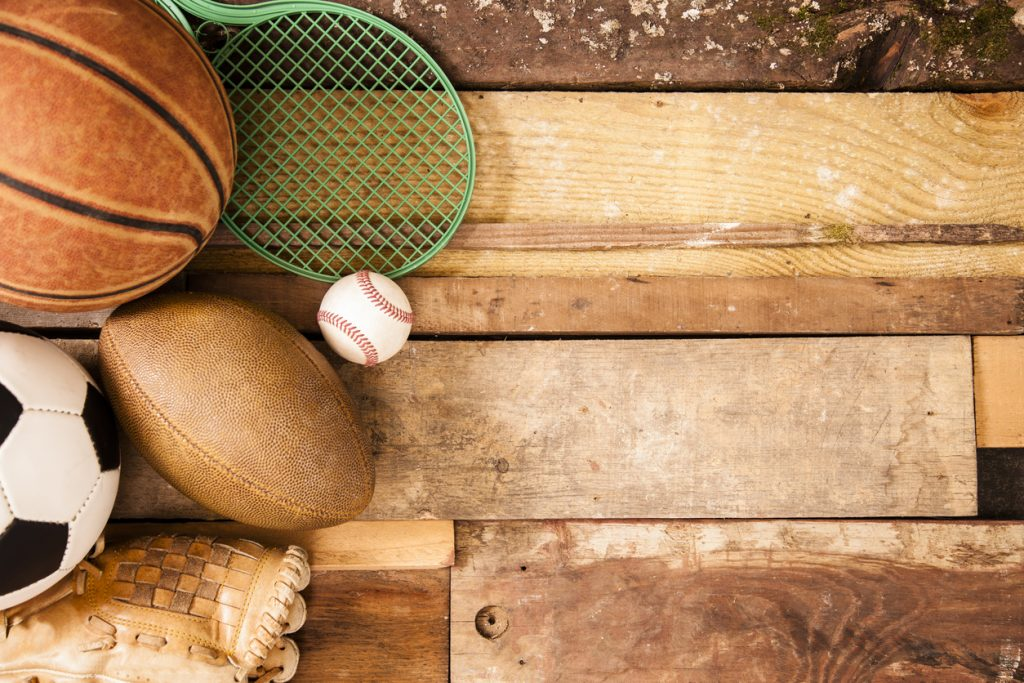 Sports Background: Equipment on unique wooden boards background.