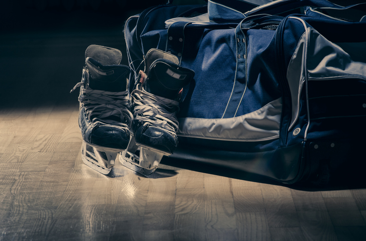 Hockey equipment left on the floor