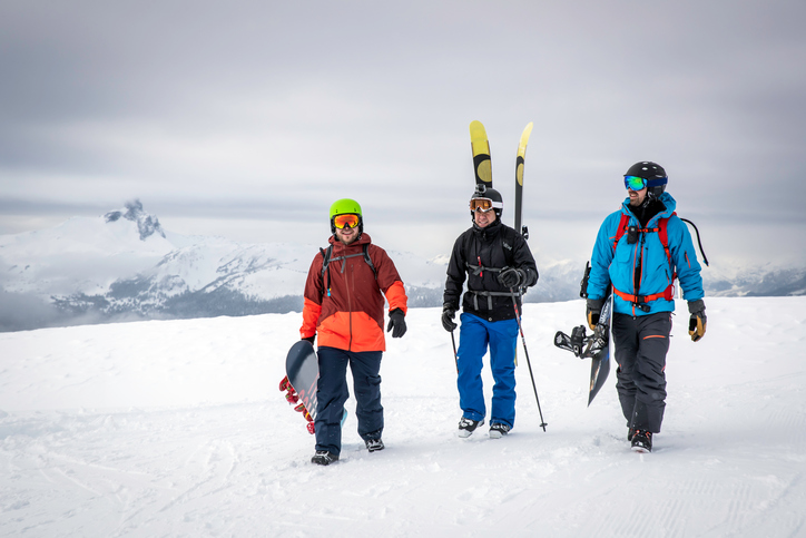 Backcountry Skier and Snowboarders on Mountain Summit