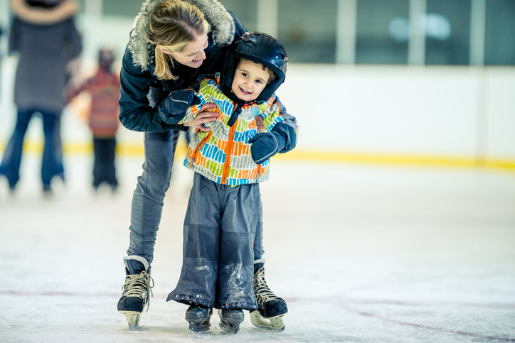Child skating with mom