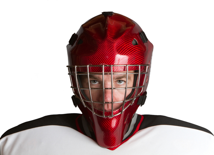 Goalie staring ahead inhelmet